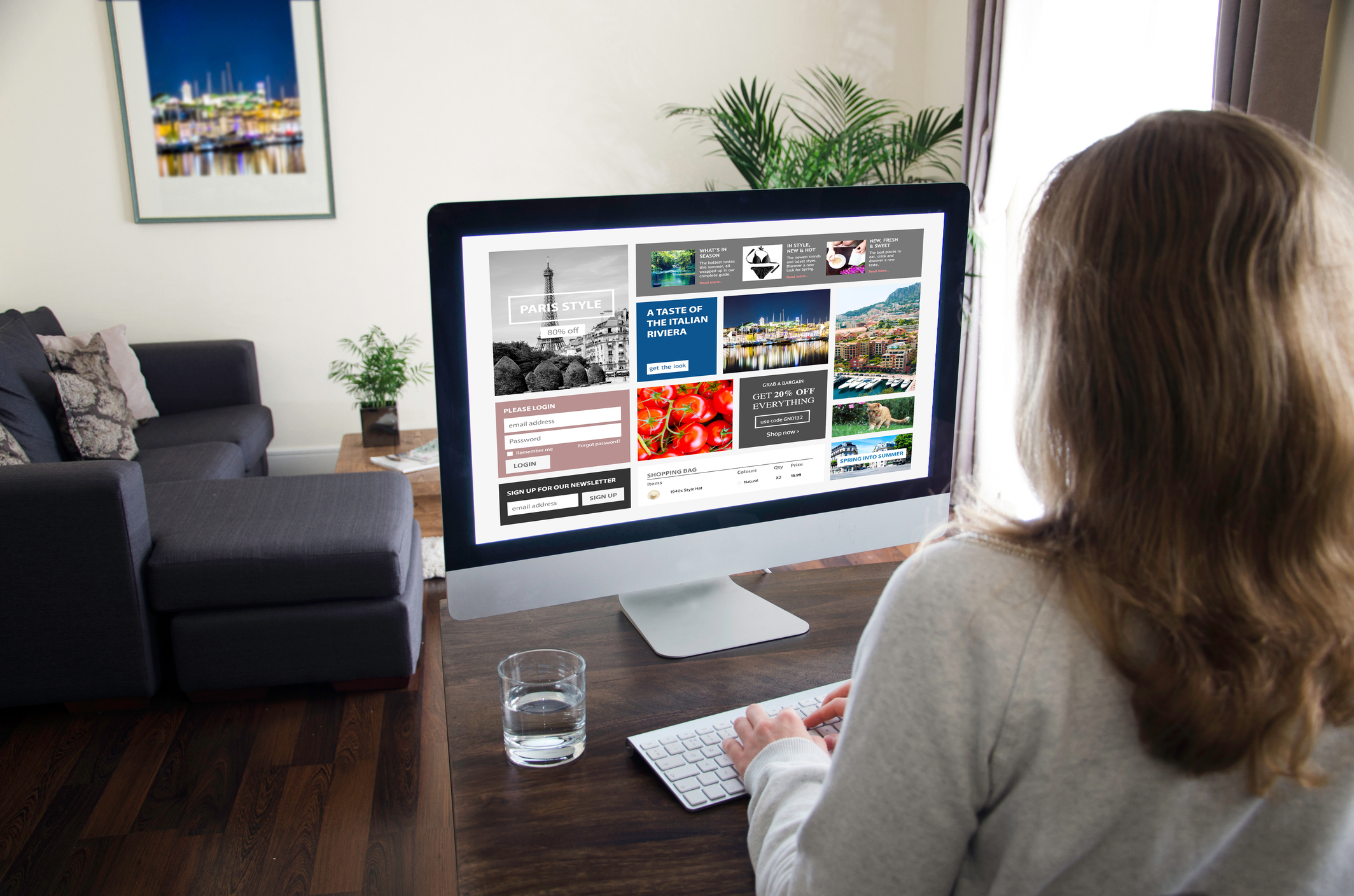 Female student sitting at home in front of a computer monitor working on designing her eportfolio