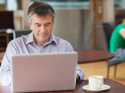 Photo of continuing professional using a laptop