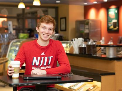 Photo of student in the cafe